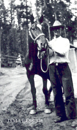 Mr. Wylie with horse, Jasper, Alberta.