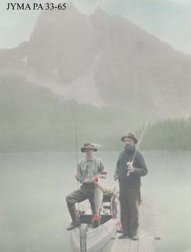 Two unidentified men with fish, British Columbia.
