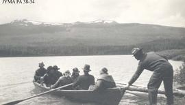 Curly Phillips with group in boat at Maligne Lake, Jasper National Park, Alberta.