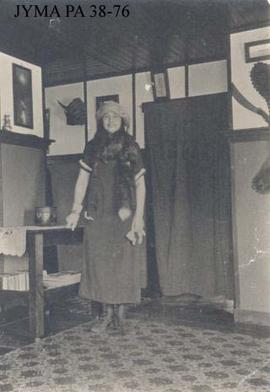 Unknown woman inside a home.