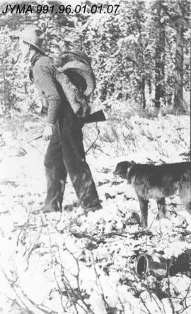 [Unidentified man with Rocky Mountain Sheep trophy], Alberta