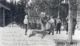 Sleigh team and skiers at Maligne Lake, Jasper National Park, Alberta.