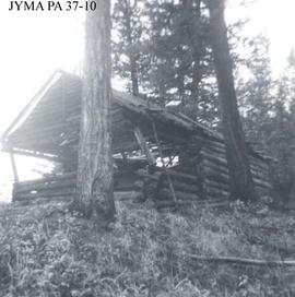 Ruins of a log cabin on Derr Creek, Alberta.