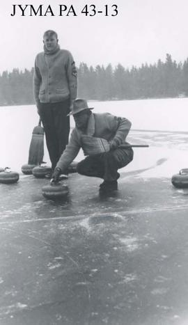 Men curling on a lake in Jasper National Park, Alberta.
