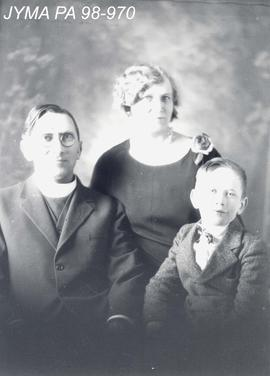 Reverend Ellison with wife and baby.