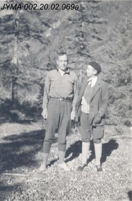Unidentified man and woman on a trail