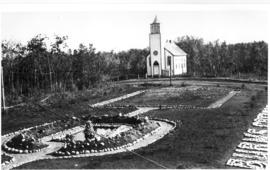 St. Norbert's Roman Catholic Church with part of Burns Creamery garden and fountain in foreground...