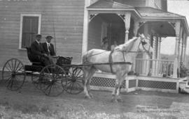 Delisle home with horse and wagon.