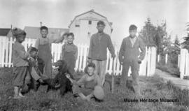 Boys in front of Saddle Lake school, Alberta