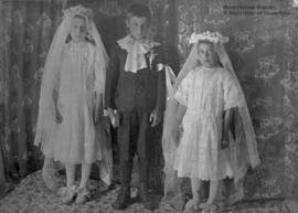 Alice, Lucien, Lucienne Pagé at first communion.
