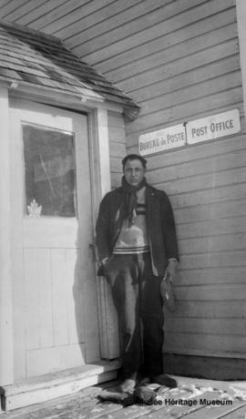 Man in front of Post Office at Saddle Lake, Alberta