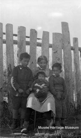 Woman and children at Le Goff, Cold Lake school, Alberta