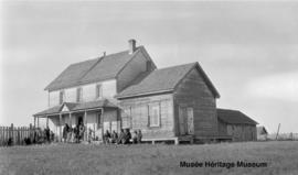 Dene families in front of Le Goff, Cold Lake school, Alberta