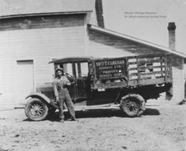 Joseph L'Hirondelle and delivery truck.
