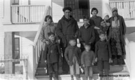 People in front of 3rd residential school at Onion Lake, Saskatchewan