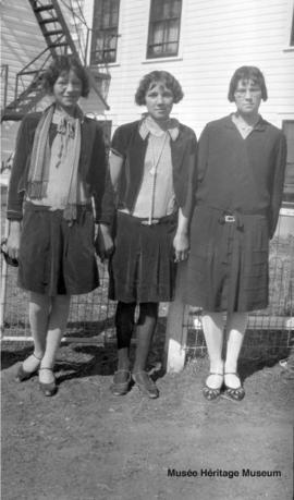 Girls in front of 3rd residential school at Onion Lake, Saskatchewan