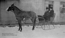 Marie Reneault and Mrs. Armstrong in horse-drawn cutter.