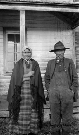 Woman and man in front of Le Goff, Cold Lake school, Alberta