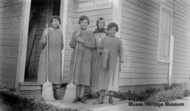 Schoolgirls and Sister Aldea Gagnon in front of Saddle Lake Post Office, Alberta