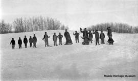 Boys tobogganing at Onion Lake, Saskatchewan