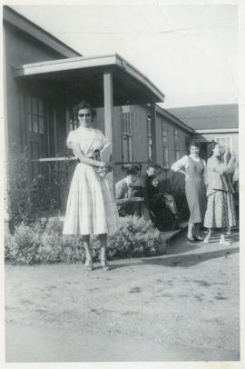 Photograph of Irene Prothroe outside a building at (the University of British Columbia?)