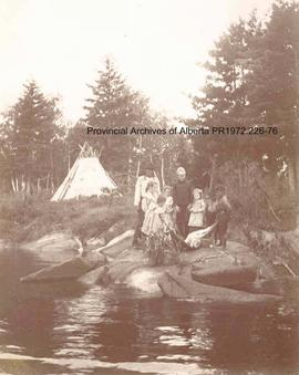 Children of the Missionary helping Chief Redsky skin a moose at Shoal Lake, Ontario
