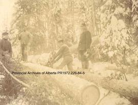 Loggers holding axes at Ingolf, Ontario