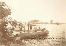 Day Star steamboat and barge at Shoal Lake, Ontario