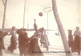 First Nations children playing a ball game in the Lake of the Woods, Ontario area