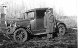 Mr. Williams and his car near Red Deer