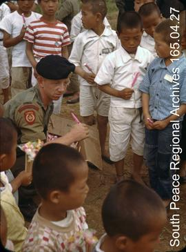 Canadian soldier with Korean children.