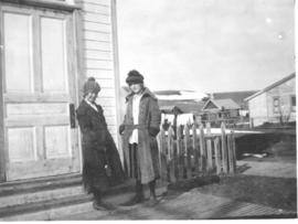 Two unidentified young women outside of a house in Okotoks, AB.