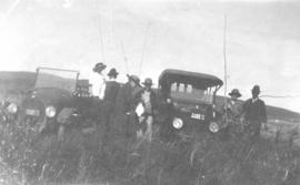 E. A. Daggett and a group of friends with a McLaughlan automobile, near Okotoks, AB.