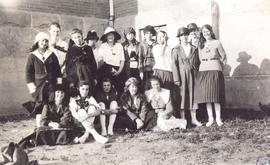 Group of 16 young women, unidentified, in courtyard of a school, either Calgary or Okotoks, AB.