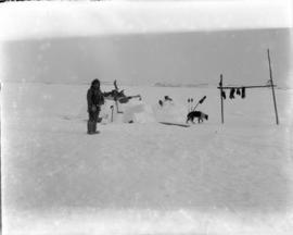 Unidentified Inuit Man in Front of Igloo