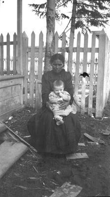 Native woman with child.