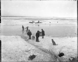 Men with Sleds and Dogs Crossing Water