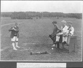Canada. Quebec. Children golfing at Metis Beach / CN123