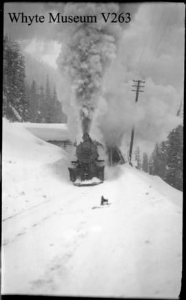 Glacier winter scene, train with snowplow