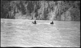 Riders fording river
