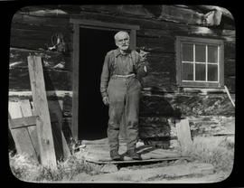 [Joe Smith in front of his cabin at Silver City]