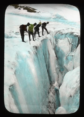[Group of Alpine Club of Canada climbers looking into crevasse]