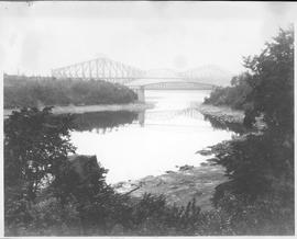 Canada. The pigmy and the giant. In the foreground is the steel bridge over the Chaudiere River a...