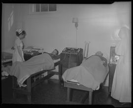 [Mineral Springs Hospital- Doctor examining patient]