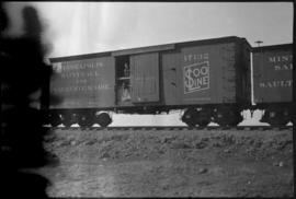 Soo Line boxcar with man and colt in door