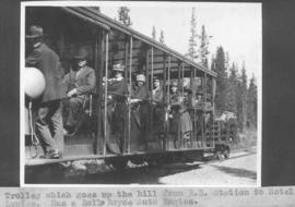 Trolley which goes up the hill from R. R. station to Hotel Lake Louise. Has a Rolls Royce auto engine / 27603