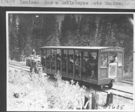 Trolley which goes up the hill from R. R. station to Hotel Lake Louise. Has a Rolls Royce auto engine / 27605