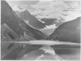 Canada. Scene in the Canadian Rockies. The mirror-like surface of Lake Louise serves to reflect t...