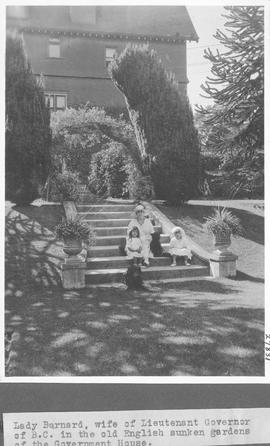 Lady Barnard, wife of Lieutenant Governor of B. C., in the old English sunken gardens of the Gove...