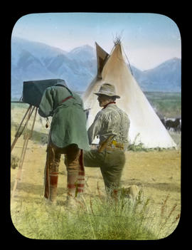 Savage and Civilized [Elliott Barnes showing Stoney First Nations man  how his camera works]